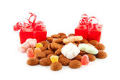 Pepernoten (ginger nuts) and presents — Stock Photo