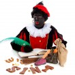Zwarte piet ( black pete) typical Dutch character — Stock Photo #7809420