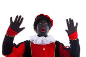 Zwarte piet ( black pete) is looking surprised — Stock Photo