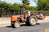 Man is driving his tractor — Stock Photo