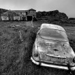Abandoned car and farm — Stock Photo