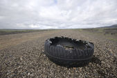 Destroyed rubber tire — Stock Photo