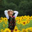 Beauty woman and sunflowers — Stock Photo