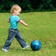 Small boy playing football in the park outdoor. Two years child — Stock Photo