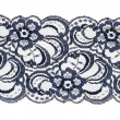 Lace trim ribbon over white. Embroidered fabric. Closeup — Stock Photo
