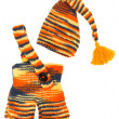 Set of kids knitted clothes: colorful baby's hat and pants. Over — Photo