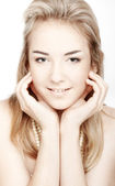 Beautiful girl with clean skin of the face. Closeup over white b — Stock Photo
