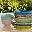 Decorated dishes and bowls on a garden table — Stock Photo