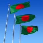 Постер, плакат: Three flags of Bangladesh against blue sky