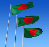Three flags of Bangladesh against blue sky. — Stock Photo