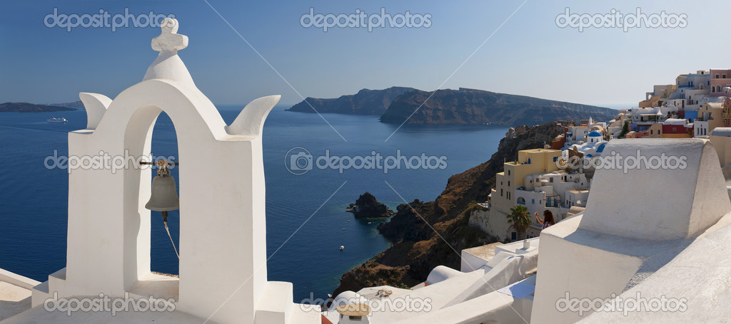 A panoramic image of the village of Oia on the greek island of Santorini.  Stock Photo #7284728