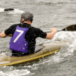 Man in kayak race — Stock Photo