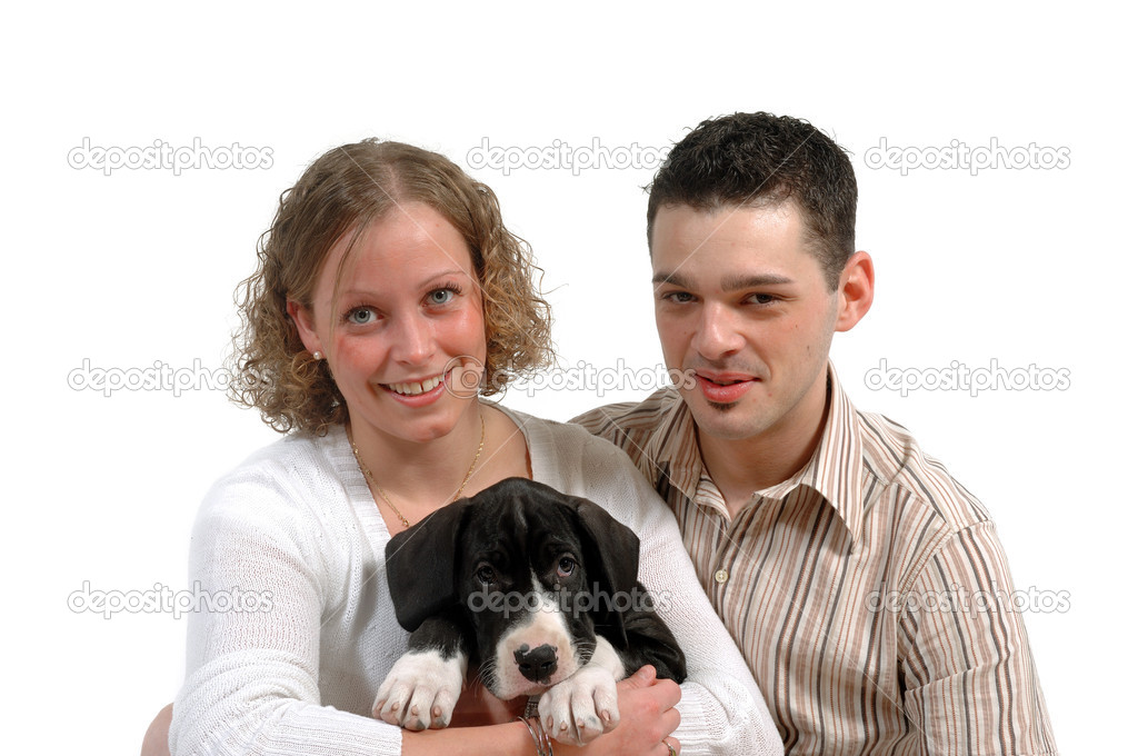Young smiling couple and a their sweet puppy. — Stock Photo #6933741