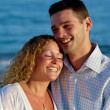 Happy young couple at beach — Stockfoto #7516115