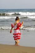 Kind op strand — Stockfoto