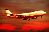 Air travel - plane and sunset — Stock Photo