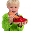 Little boy with carrot for Dutch Sinterklaas — Stockfoto