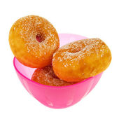 Pink bowl sugary donuts — Stock Photo