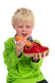 Little boy with carrot for Dutch Sinterklaas — Stock Photo