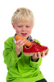 Malý chlapec s mrkví pro nizozemské sinterklaas — Stock fotografie