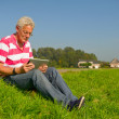 Senior with tablet PC outdoor — Stock Photo #7101604