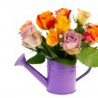Colorful bouquet roses in watering can — Stock Photo