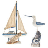 Old miniature sailboat and sea gull — Stock Photo