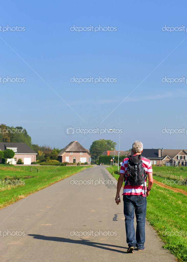 Man is hiking with back pack in Holland — Stock Photo #7718791
