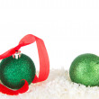 Green Christmas balls in snow — Stock Photo