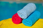 Towels near swimming pool — Stock Photo