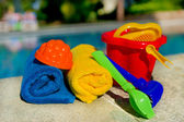 Toys and towels at the swimming pool — Stock Photo