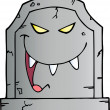 Laughing Evil Headstone - Stock Photo