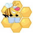 Royalty-Free Stock Photo: Worker Bee Carrying Two Buckets Over Honey Combs