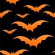 Stock Vector: Orange bats on black, eps 10
