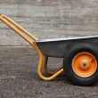 Orange two weel wheelbarrow — Stock Photo