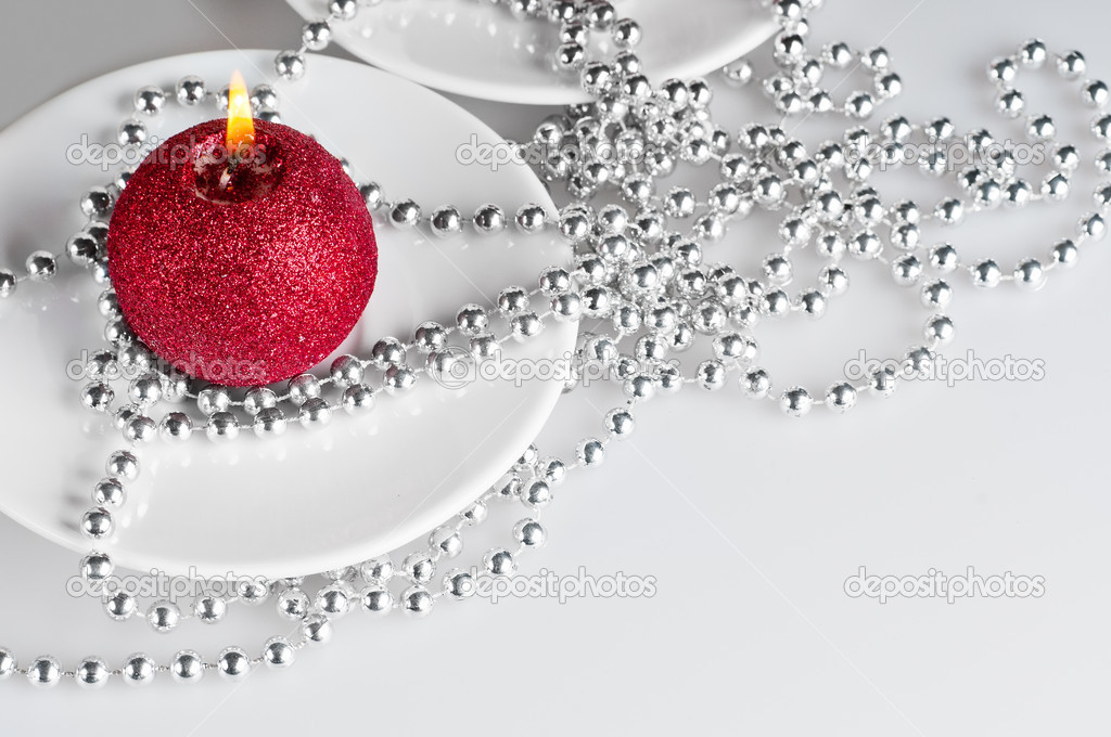 The christmas still life - silver pearls and candle.  Stock Photo #6914963