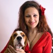 Gipsy girl with beagle. — Stock Photo