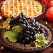 Red grapes and apple pie - Stock Photo