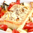 Baked Feta cheese with vegetables - Stock Photo