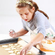 Cute girl baking cookies — Stock Photo #7495525