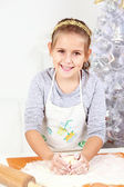 Cute girl baking cookies — Stock Photo