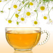 Royalty-Free Stock Photo: Cup of chamomile tea with fresh chamomilla flowers over colored background