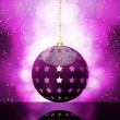 Glowing purple christmas bauble — Stock Vector