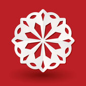Paper snowflake on red — Stock Vector