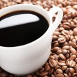 Coffee beans and cup — Foto de Stock