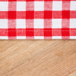 Foto Stock: Checkered tablecloth on wooden table