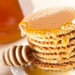 Waffle with honey — Stock Photo