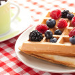 Tasty waffle with fruits — Stock Photo
