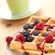 Tasty waffle with fruits — Stock Photo #6999435