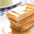 Waffle with honey — Stock Photo #6999677